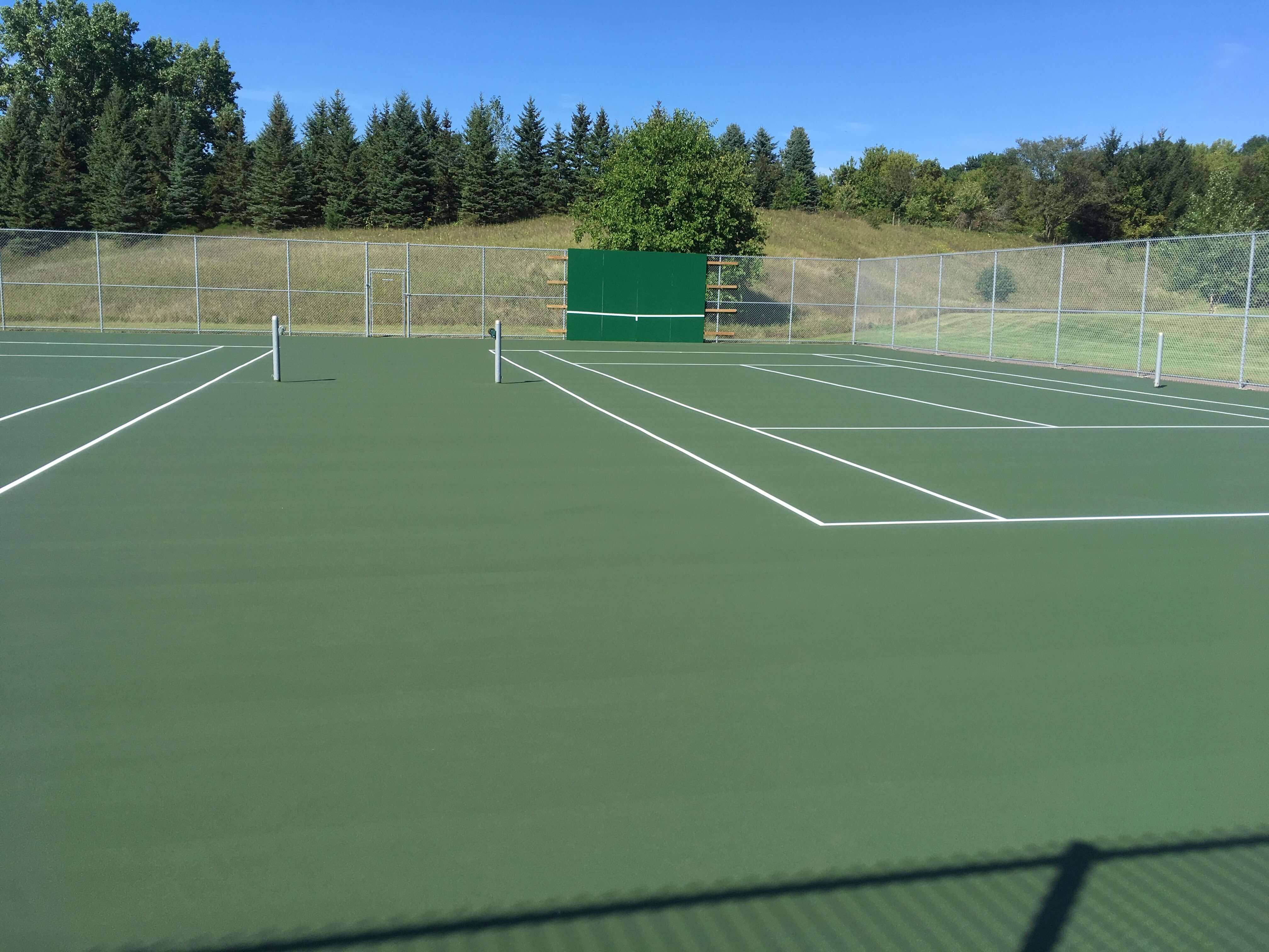 Tennis court after completed resurfacing and crack repair by C & H Sport Surfaces, Inc