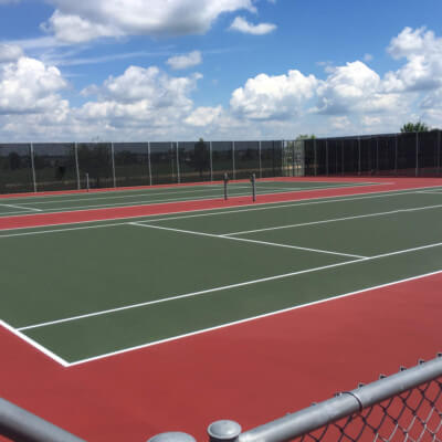 Red and Green Tennis Courts Local School