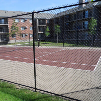 Brown tennis court for local complex