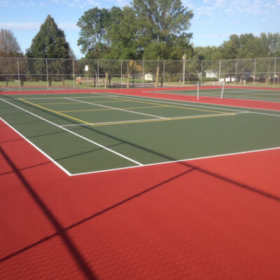 Red and Green thennis court with pickleball lines yellow