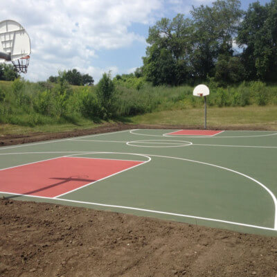 Full sized red and green basketball court