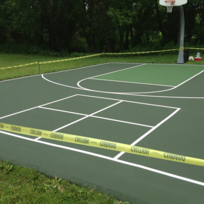 Green basketball court with foursquare lines