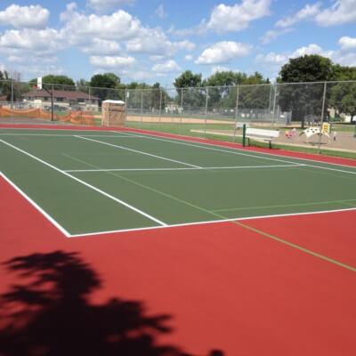 Green and red tennis court with pickleball lines
