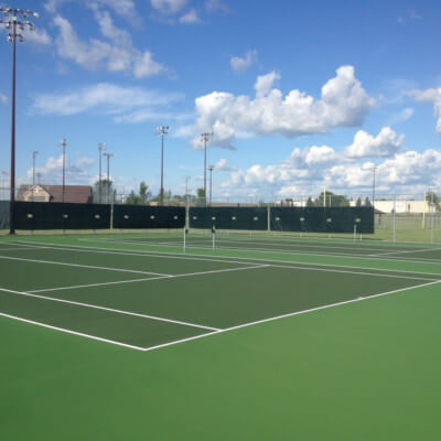Windscreens attached to fence surrounding Tennis Courts
